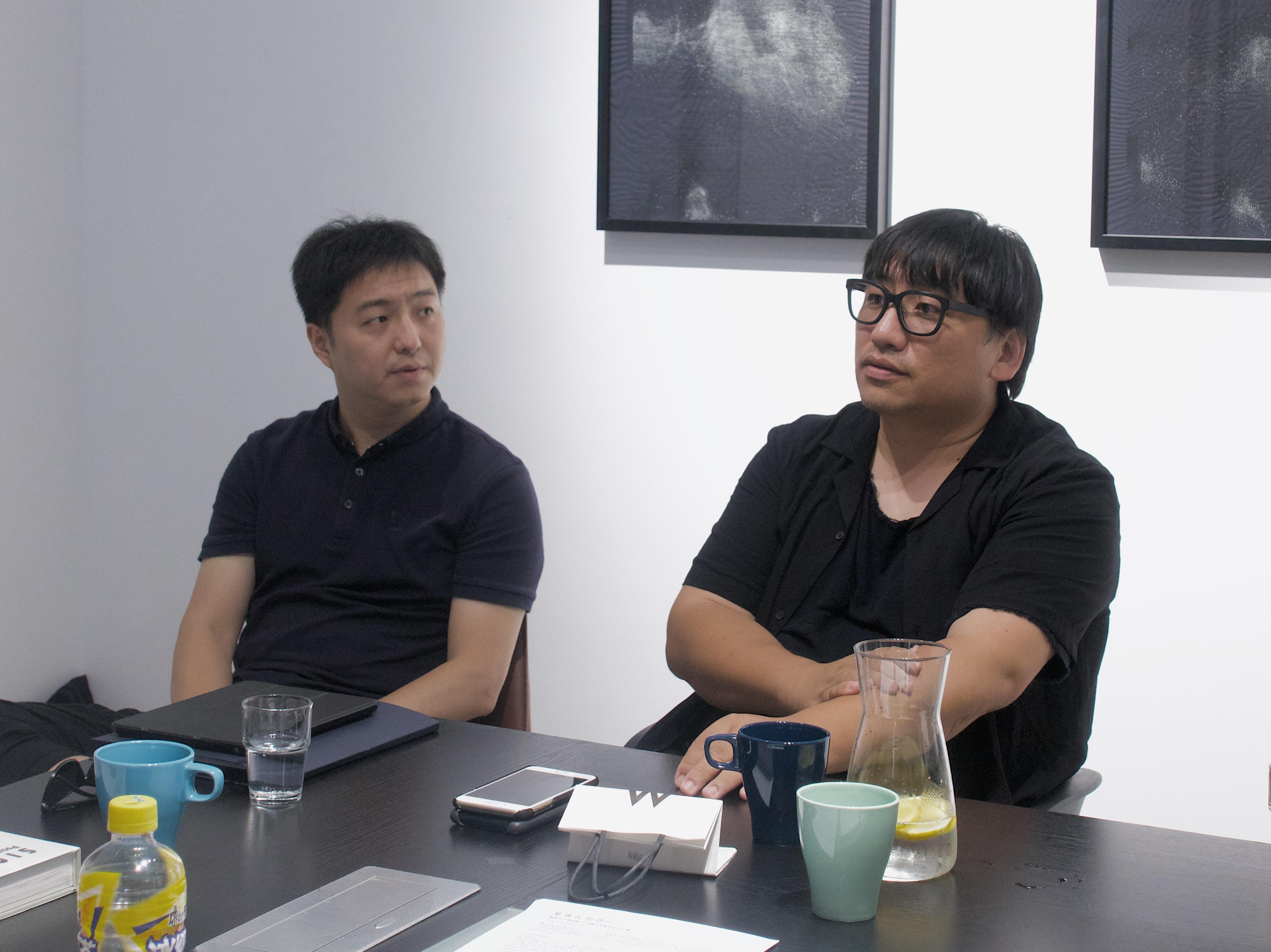 Curator Zheng Wen (left) and Curator Li Zhenhua (right)