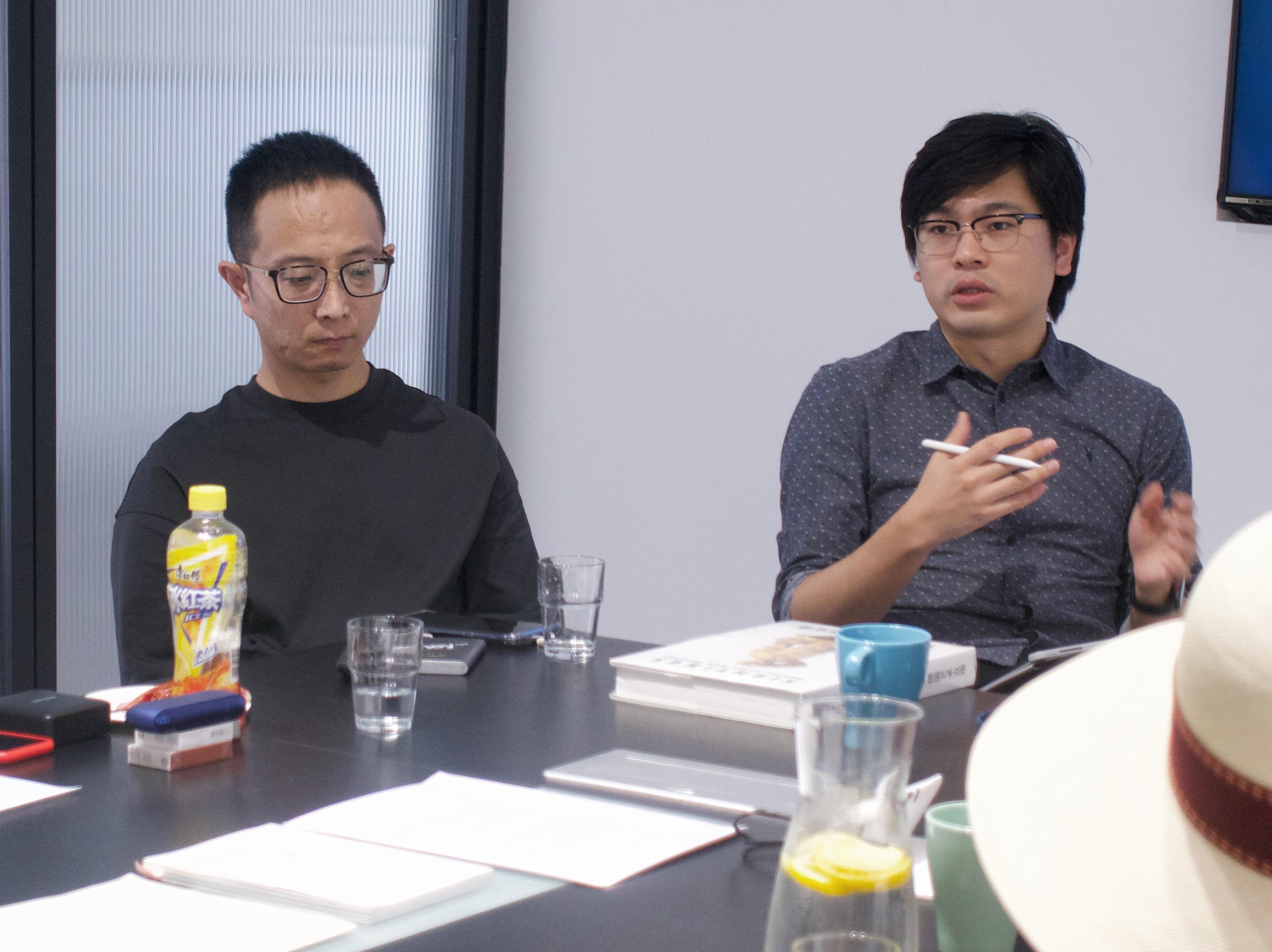 Artist Zheng Da (left) and Gallery Owner TD Yang (right)